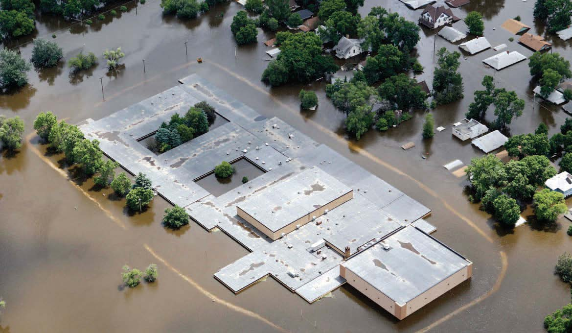 Floodwater from the Souris River surrounds the Ramstad Junior High School in Minot, N.D., on Monday, June 27, 2011. (AP Photo/Charles Rex Arbogast).