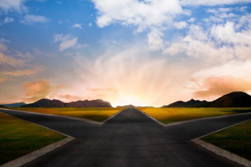 crossroad at dawn in rural landscape