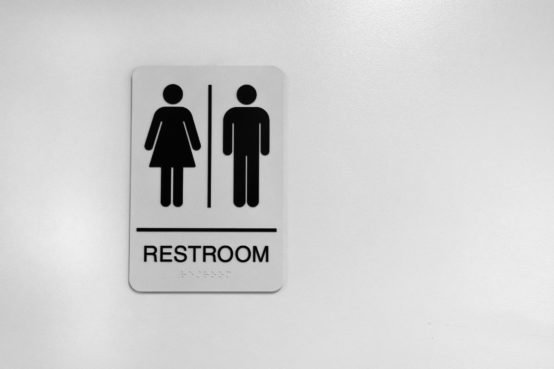 An image of a black and white public washroom sign.