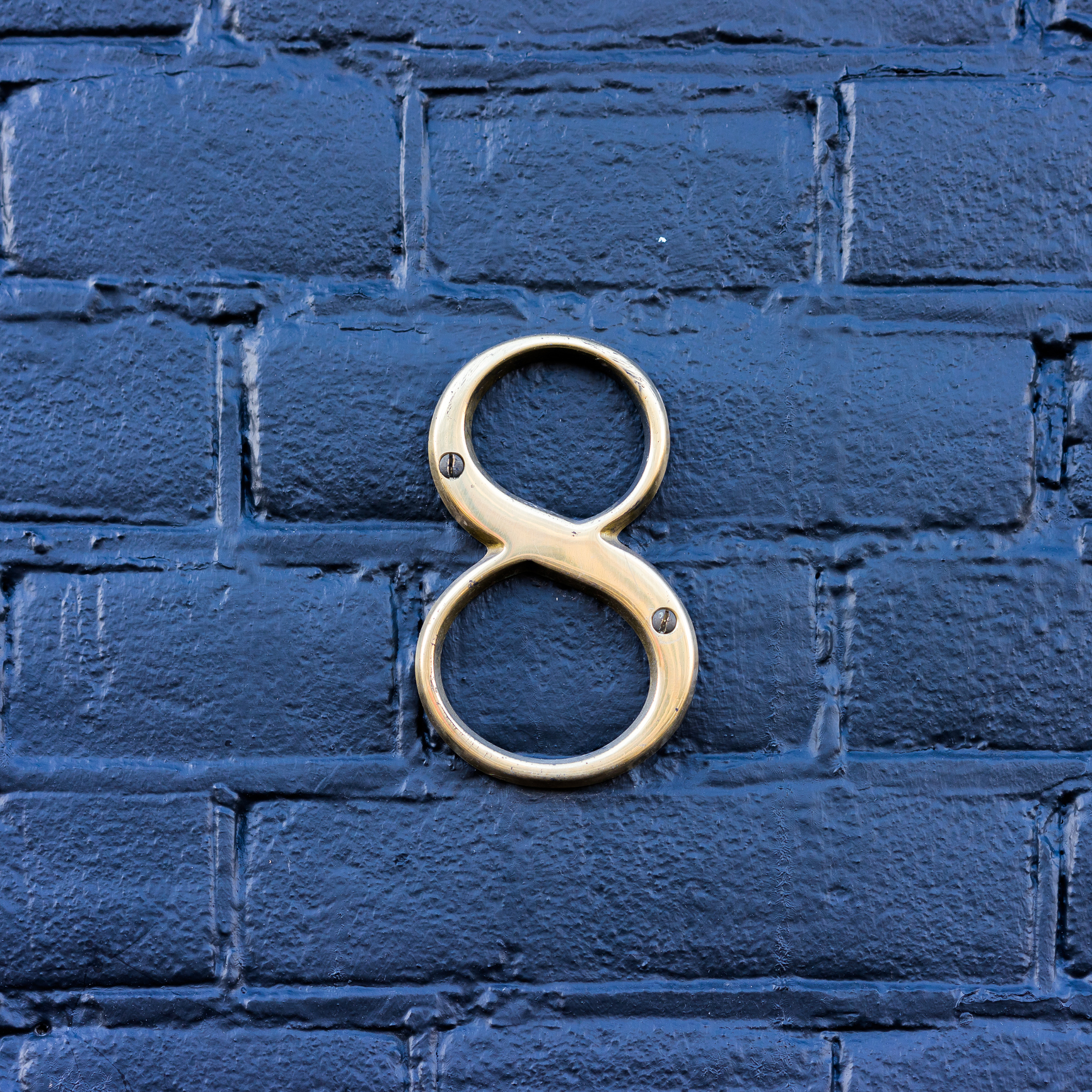 Gold colored house number eight