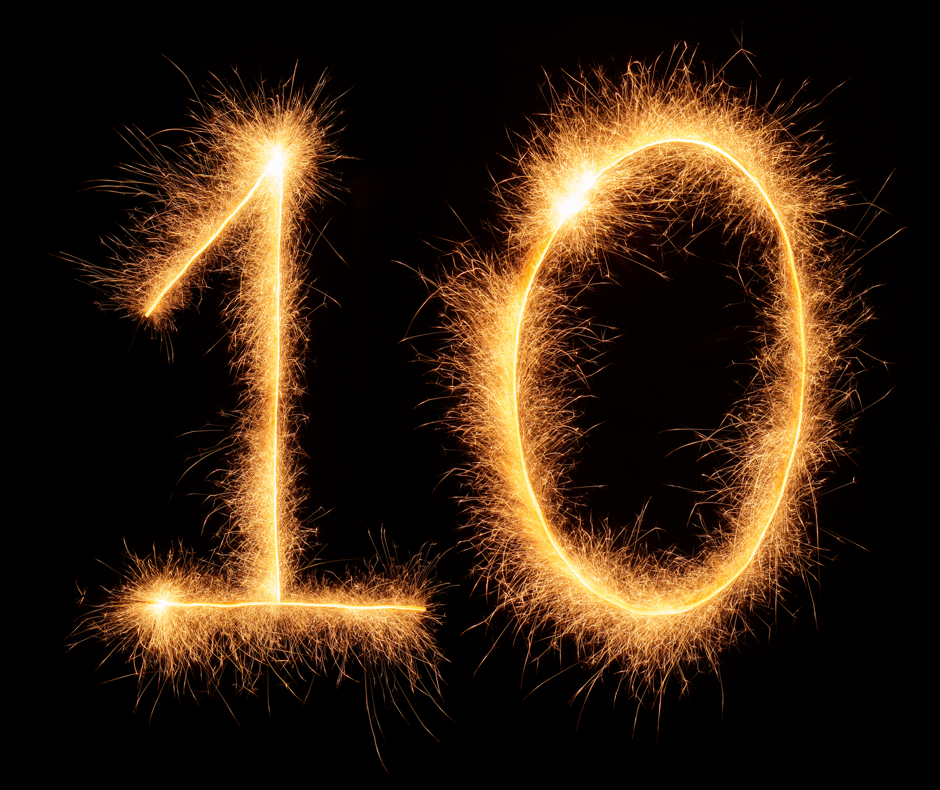 """10"" number drawn with bengali sparkles isolated on black background"
