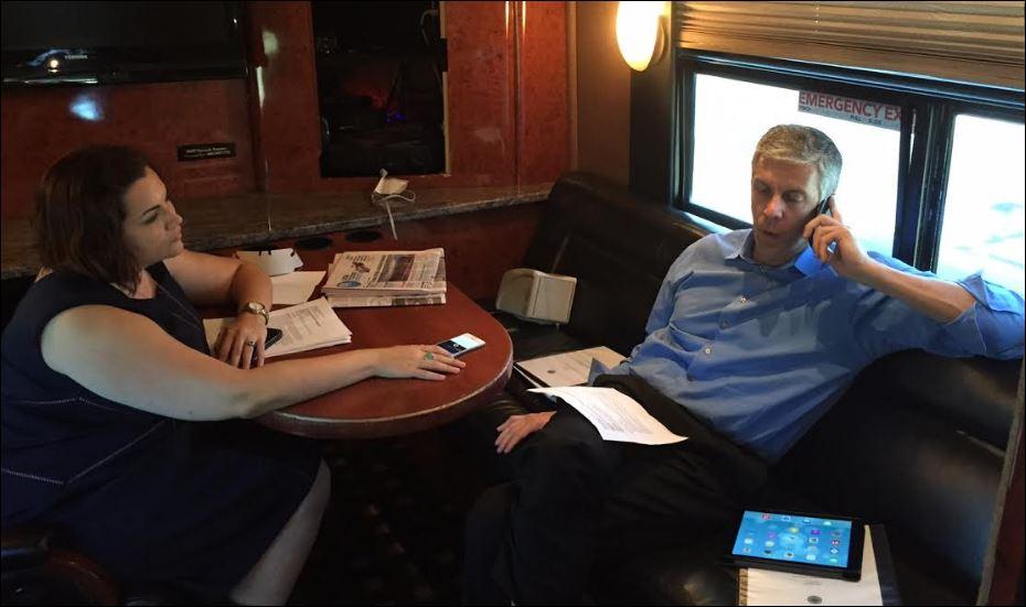 turner nolt and arne duncan on the bus doing interviews